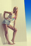 Blonde girl with denim shorts in full lenght Royalty Free Stock Photo