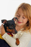 Blonde girl with dog Royalty Free Stock Images