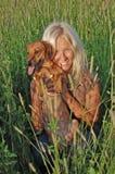 Blonde girl with dog Stock Photos