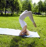Blonde girl doing yoga in green park Royalty Free Stock Images