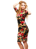 Blonde girl in dress with roses pattern Royalty Free Stock Image