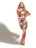 Blonde girl in dress with roses pattern Royalty Free Stock Photos