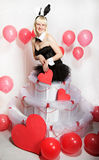 The blonde girl dressed as a playboy Bunny for Valentine's day Stock Photography