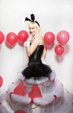 The blonde girl dressed as a playboy Bunny for Valentine's day Royalty Free Stock Photos