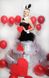 The blonde girl dressed as a playboy Bunny for Valentine's day Stock Images