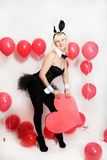 The blonde girl dressed as a playboy Bunny for Valentine's day Stock Photo