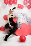 The blonde girl dressed as a playboy Bunny for Valentine's day Stock Image