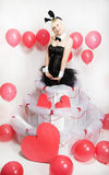 The blonde girl dressed as a playboy Bunny for Valentine's day Royalty Free Stock Photography