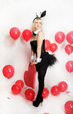 The blonde girl dressed as a playboy Bunny for Valentine's day Royalty Free Stock Photo