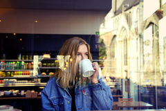 Blonde girl drinking Royalty Free Stock Photos