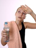 Blonde girl in drinking water after sport Royalty Free Stock Image