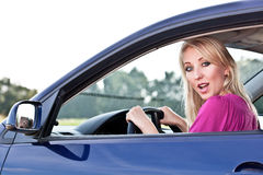 Blonde girl driver. Beautiful blonde girl driving a car Royalty Free Stock Images