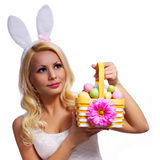 Blonde girl with easter basket isolated Stock Photography