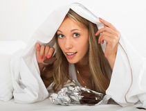 Blonde girl eating chocolate and smiling Royalty Free Stock Photo