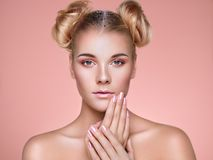 Blonde girl with elegant and shiny hairstyle royalty free stock photography