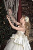 Blonde girl in evening dress princess Royalty Free Stock Photography
