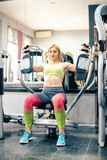 Blonde girl exercising at gym Royalty Free Stock Photography