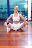 Blonde girl exercising yoga Stock Images