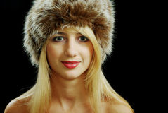 Blonde girl face closeup in fur hat Royalty Free Stock Photo