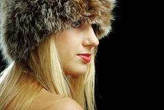Blonde girl face closeup in fur hat Stock Photos