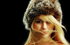 Blonde girl face in fur hat, naked shoulders Royalty Free Stock Image