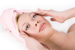 Blonde girl facial massage Royalty Free Stock Photo