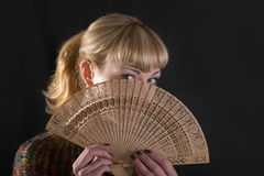 Blonde girl with a fan Royalty Free Stock Photos