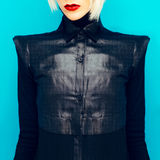 Blonde girl in fashionable black shirt Royalty Free Stock Images