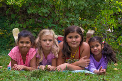 Blonde girl feel bad in gypsy children family with half sisters stock image