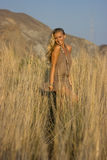 Blonde girl in the field Royalty Free Stock Photos