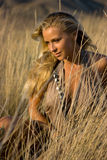 Blonde girl in the field Stock Photos