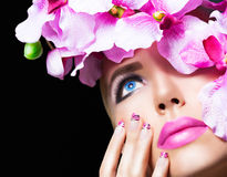 Blonde girl with flowers and perfect makeup Stock Photography