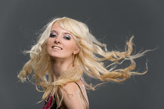 Blonde girl with flying long hair Royalty Free Stock Photo