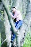Blonde girl in the forest Royalty Free Stock Images