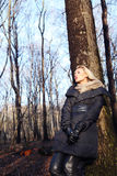 Blonde girl in forest. Royalty Free Stock Photography
