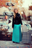Blonde girl and fountain Royalty Free Stock Image