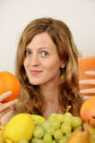 Blonde girl with fresh fruits and orange juice Stock Photos