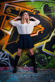Blonde girl in front of graffiti Stock Images