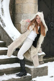 Blonde girl in fur coat Stock Images
