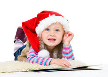 Blonde girl in a fur jacket and a red Santa's cap Stock Image