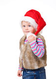 blonde girl in a fur jacket and a red Santa's cap Stock Photography