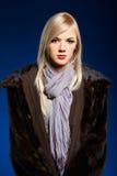 Blonde girl in furs Stock Image