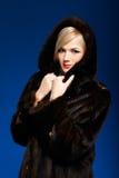 Blonde girl in furs Royalty Free Stock Photos