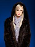 Blonde girl in furs Stock Photo