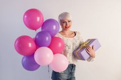 Blonde girl with gifts and balloons for the birthday. 1 Royalty Free Stock Image