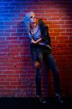 Blonde girl glam rocker Stock Images