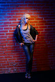 Blonde girl glam rocker Stock Images