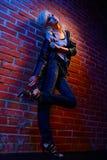 Blonde girl glam rocker Royalty Free Stock Image