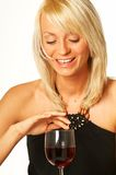 Blonde girl with glass of wine. Close up royalty free stock photography