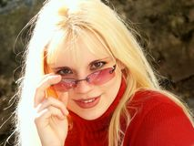 Blonde girl with glasses. Blonde in red with glasses (horizontal shot Royalty Free Stock Photo